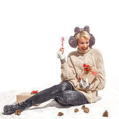 Beautiful, young, cheerful girl in the snow with Christmas shopping and gifts. Christmas holidays, New Year's mood.