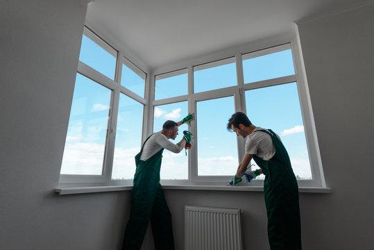 Two men are repairing home