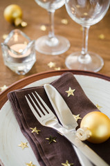Christmas table place setting in vintage or rustic style.
