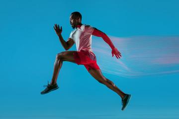 Fototapeta Full length portrait of active young muscular running man, obraz
