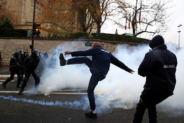 French ambulance drivers face off with French riot police during a demonstration at the Place de la Concorde in Paris