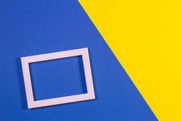 Abstract geometric shapes colored paper texture background with empty picture frame