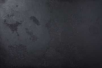 Black elite texture with grooves. Not a flat design surface. Black texture can be used for background.