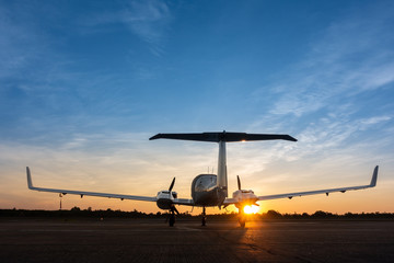 Shadow of a small landed plane  on the airfield and the Beautiful sunset sky background