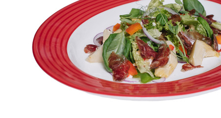 Fresh salad with fresh vegetable salad and lean meat, arugula and tomato. Top view. restaurant menu. isolated on white background