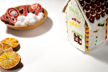 Christmas card: on a wooden plate are red ginger cookies in the shape of numbers 2019 and white round snowflakes