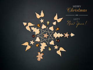 merry christmas lettering and christmas star shaped out of different Christmas deco items