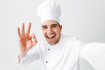 Happy chef cook wearing uniform standing
