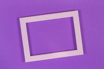 Blank empty frame on violet purple color paper background