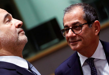Italian Economy Minister Giovanni Tria and European Commissioner for Economic and Financial Affairs Pierre Moscovici attend a Euro zone finance ministers meeting in Brussels