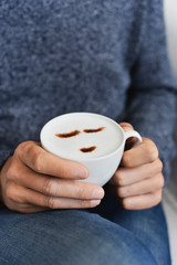 man with a cup of cappuccino.