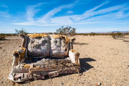 A decaying old couch abandoned in the desert, southern California