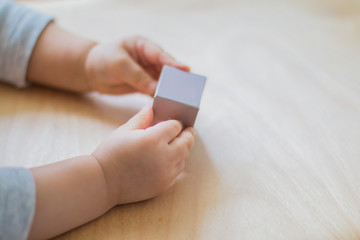 baby playing with paper cube