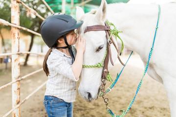 Affectionate Girl Kissing Equine