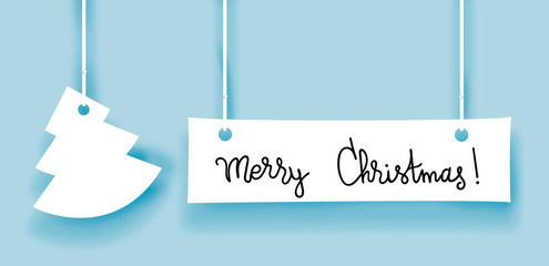 Merry christmas words and fir made of paper label