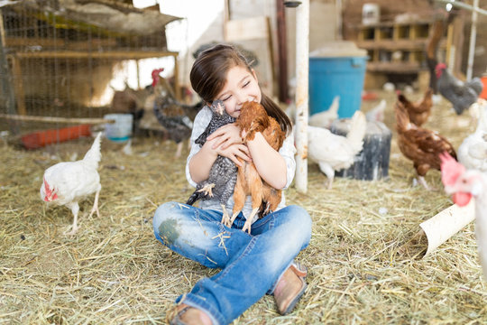Happy Girl In Love With Chickens