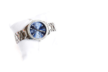 wrist watch on white pad isolated