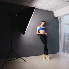 sportswear advertisement photo shoot, active lifestyle and fitness apparel, female fashion model posing at studio