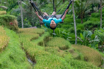 Young Boy Swinging Over the Tegalalang Rice Fields in Bali, Indonesia