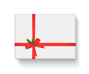 White gift box with red ribbon and bow on white background. Merry Christmas and Happy New Year. Vector illustration