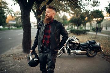 Bearded biker with helmet