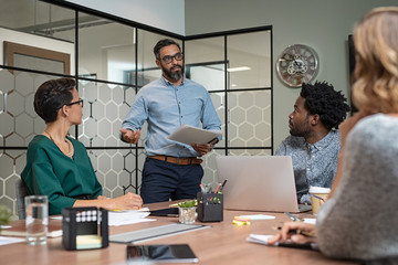 Man giving presentation in boardroom