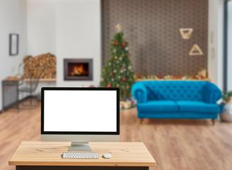 Christmas promotion via internet, computer screen and Christmas living room.