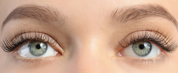 Closeup view of beautiful young woman with eyelash extensions