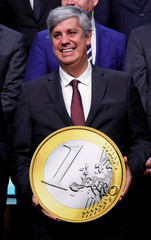 Eurogroup President Mario Centeno takes part in a group photo while celebrating the 20th anniversary of the euro during a eurozone finance ministers meeting in Brussel