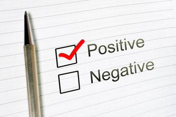 questionnaire: positive choice or negative, marked check box with a pen on lined paper background. Approval concept