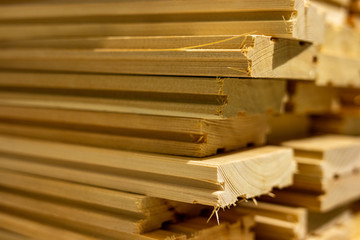 Stack of boards. Industrial background. Floor boards. Larch boards. Boards with grooves. Wooden planks