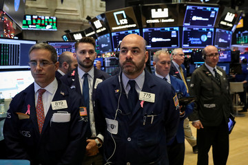 Traders hold moment of silence in honor of former U.S. President Bush on NYSE floor in New York