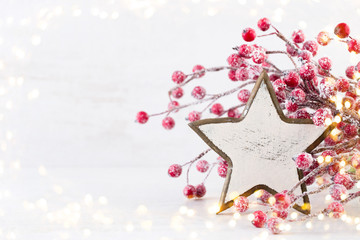Christmas greeting card. Christmas tree branch on glitter golden bokeh lights background. New Year concept. Copy space.