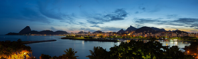 Beautiful panoramic view of the city of Rio de Janeiro with sugar loaf and corcovado at dusk.