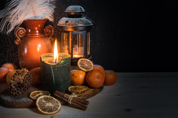 Christmas still life with candles, spices and cinnamon