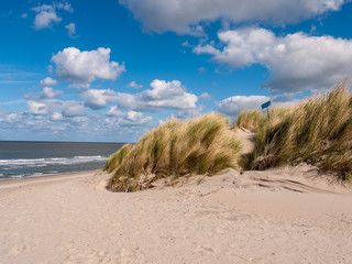 Dune covered with grass in the front of the noth sea at the beach in Niew Hamstede on the island Walcheren in the Netherlands