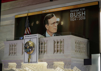 Video screen displays a tribute in honor of former U.S. President George H.W. Bush on the bell podium at the NYSE before the start of trading in New York