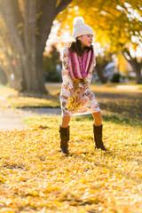 Girl holding leaves