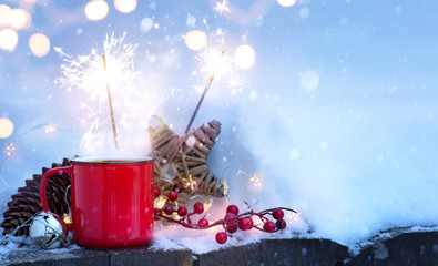 christmas holidays background; winter hot drink and Christmas holidays Light on snow;