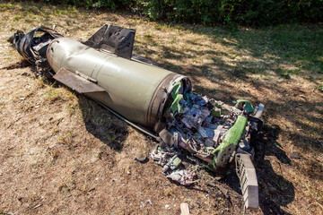 Engine and electronic stuffing of damaged ballistic missile after it fell, Ukraine and Donbass war conflict