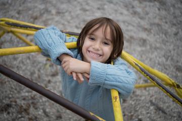 cute little boy having fun in playground