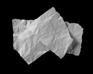 Crumpled paper scraps isolated on black background with clipping path