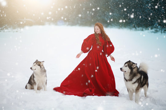 Woman on red dress with dogs