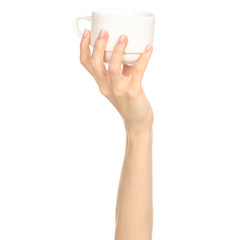 White cup mug in hand arm raised up on white background isolation