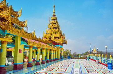 The brightly colored buildings of Soon Oo Ponya Shin Paya (Summit Pagoda) with golden pyatthat roofs, tiled columns and floor with geometric patterns, on February 21 in Sagaing