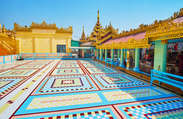 SAGAING, MYANMAR - FEBRUARY 21, 2018: The geometric patterns of colored tile on the floor in courtyard of Soon Oo Ponya Shin Paya (Summit Pagoda), on February 21 in Sagaing