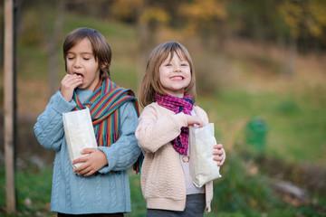 kids in park eating popcorn in park