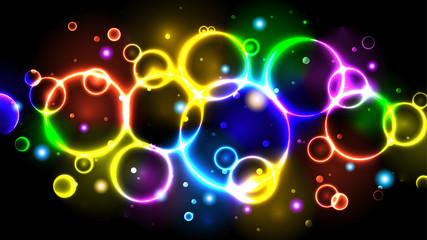 Rainbow neon color bright bubbles, abstract multicolor background with circles, sparkles and bokeh