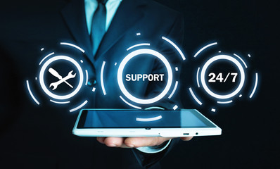 Man holding tablet. 24/7 Support Service