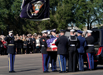 Flag-draped casket of former U.S. President Bush is carried by a joint services military honor guard in Houston
